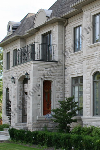 Exterior limestone facades project in new york for Limestone homes designs