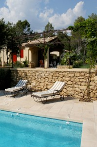 french limestone tiles around pool